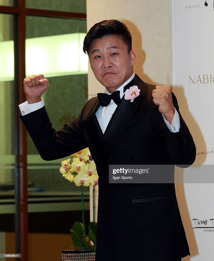 Hong Rok-G poses for photographs before his wedding ceremony at Convention diaMant on December 16, 2012 in Seoul, South Korea.