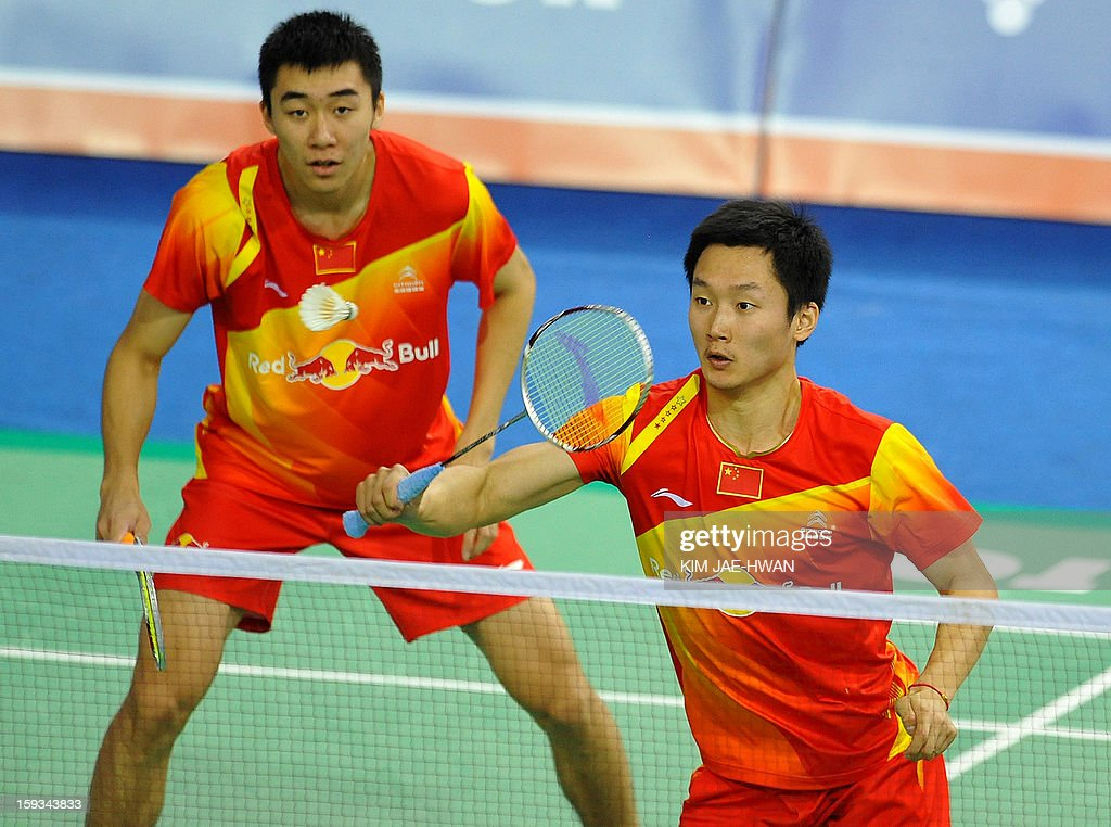 Hong Wei (L) and Shen Ye of China play a shot during their men's doubles badminton match against Mathias Boe and Carsten Mogensen of Denmark during the semi-finals of the Korea Open at Seoul on January 12, 2013. Mathias Boe and Carsten Mogensen won the match 19-21, 21-10, 21-18. AFP PHOTO / KIM JAE-HWAN