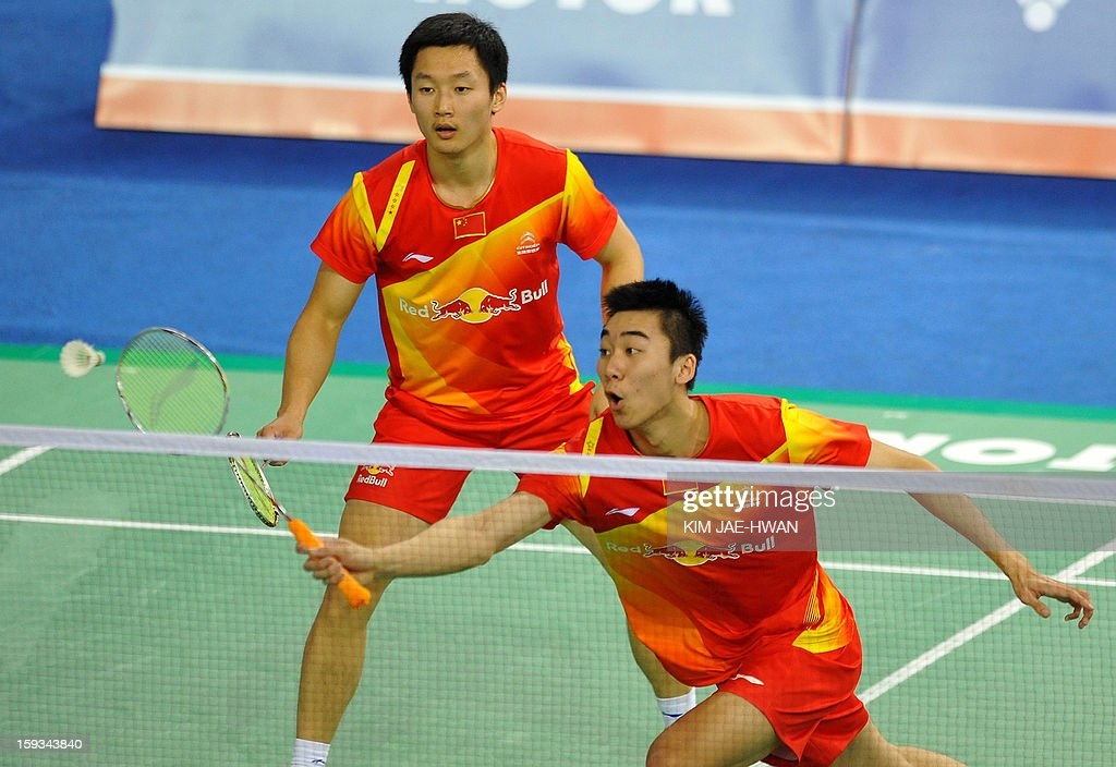 Hong Wei (R) and Shen Ye of China play a shot during their men's doubles badminton match against Mathias Boe and Carsten Mogensen of Denmark during the semi-finals of the Korea Open at Seoul on January 12, 2013. Mathias Boe and Carsten Mogensen won the match 19-21, 21-10, 21-18.