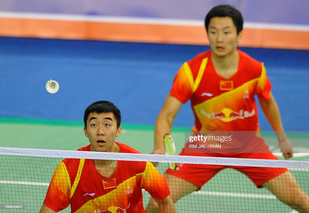 Hong Wei (L) and Shen Ye of China play a shot during their men's doubles badminton match against Mathias Boe and Carsten Mogensen of Denmark during the semi-finals of the Korea Open at Seoul on January 12, 2013. Mathias Boe and Carsten Mogensen won the match 19-21, 21-10, 21-18.