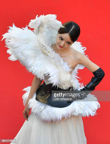 Hong Xiaoqiao poses upon arriving on May 17 2017 for the screening of the film 'Ismael's Ghosts' during the opening ceremony of the 70th edition of...