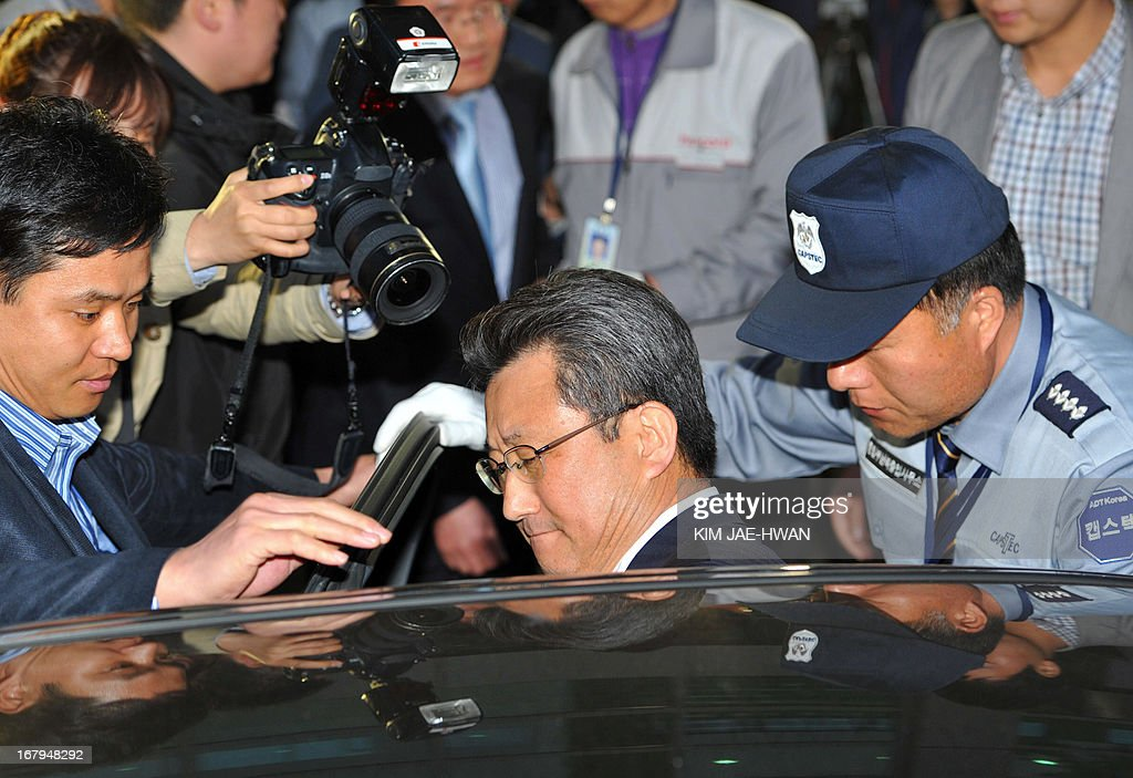 Hong Yang-Ho (C), head of the Kaesong Industrial District Management Committee, gets into a car as he leaves a border checkpoint in Paju on May 3, 2013, after days of talks with North Korean officials in the closed joint industrial zone. South Korea on May 3 withdrew its last remaining workers from the zone at risk of permanent closure due to soaring military tensions.