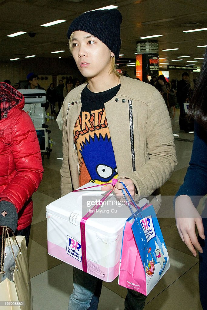 Honggi (Hong Gi) of South Korean boy band FTisland is seen at Gimpo International Airport on February 8, 2013 in Seoul, South Korea.