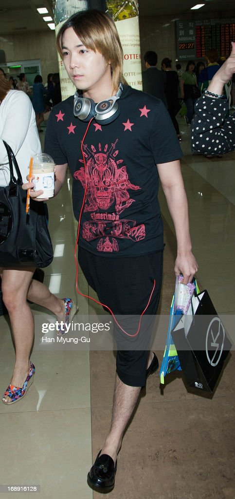 Honggi of South Korean boy band FTisland is seen upon arrival at Gimpo International Airport on May 16 2013 in Seoul South Korea