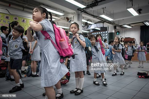 HongKongChinaeducationFEATURE by Aaron TAM Laura MANNERING This photo taken on September 1 2015 shows children proceeding to their classrooms on the...