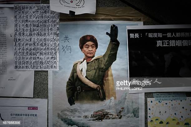 HongKongChinapoliticsdemocracyartFOCUS by Sarah Titterton A poster showing a caricature of Hong Kong Chief Executive Leung Chunying is displayed at...