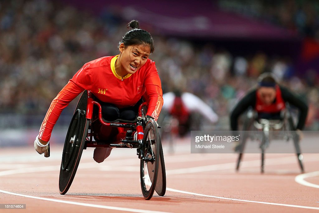 Hongzhuan Zhou of China crosses the line to win gold in the Women's 400m T53 Final on day 10 of the London 2012 Paralympic Games at Olympic Stadium on September 8, 2012 in London, England.