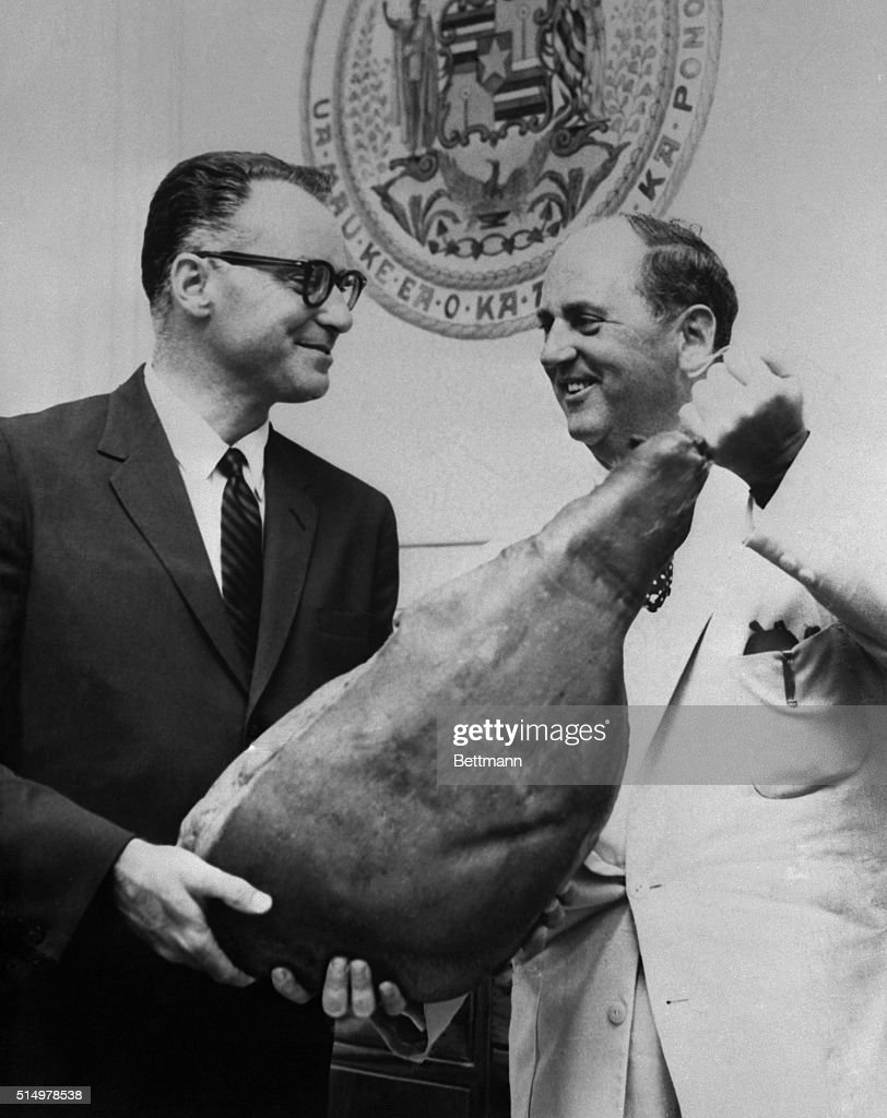 Col Tom Parker Elvis Presley's manager presents Gov William F Quinn of Hawaii a Tennessee ham in honor Proclamation Day in the islands Tennessee...