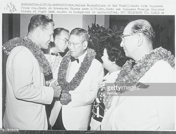 Governor Nelson Rockefeller of New York chats with Japanese Prime Minister Hayoto Ikeda at the governors dinner Mrs Ikeda and Japanese Foreign...