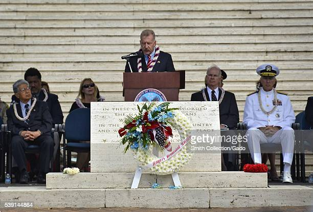 Honolulu Mayor Peter Carlisle delivers remarks during the Mayor's Memorial Day Ceremony at the National Cemetery of the Pacific at Punchbowl to honor...