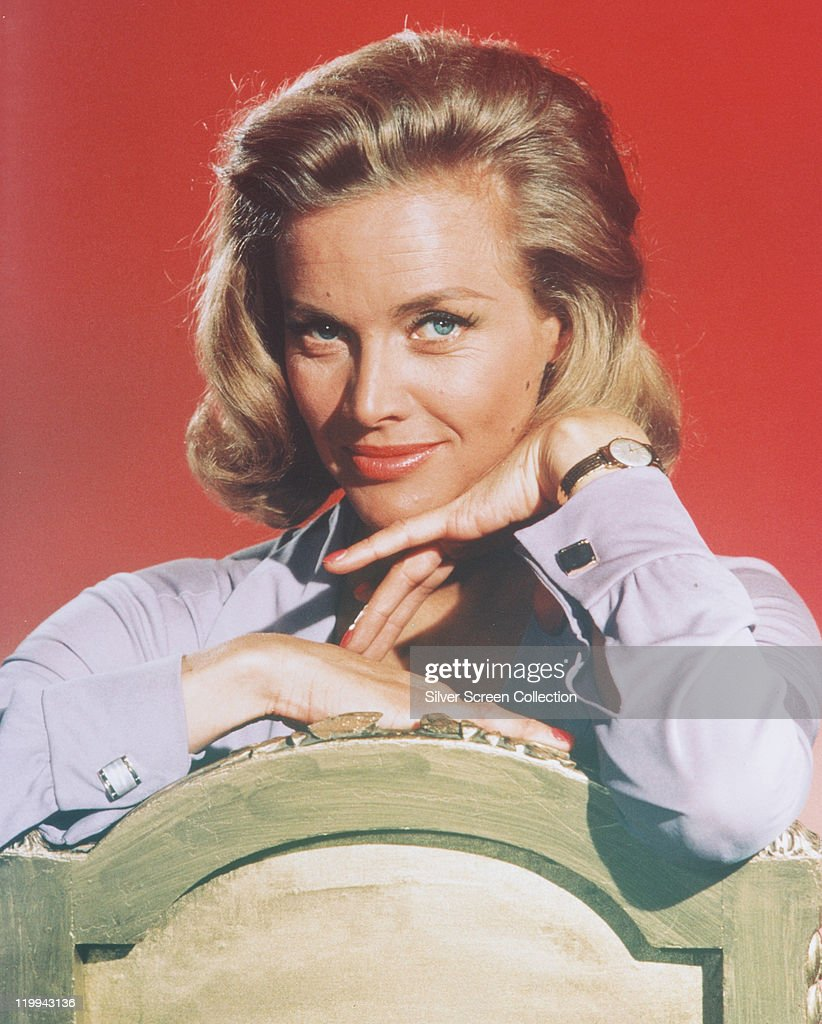 <a gi-track='captionPersonalityLinkClicked' href=/galleries/search?phrase=Honor+Blackman&family=editorial&specificpeople=215433 ng-click='$event.stopPropagation()'>Honor Blackman</a>, British actress, posing in a studio portrait, aginst a red background, issued as publicity for the film, 'Goldfinger', circa 1964. The James Bond film, directed by Guy Mailton, starred Blackman as 'Pussy Galore'.