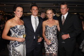 Honor Dillon All Black player Daniel Carter Mandy Barker and Team New Zealand Skipper Dean Barker pose during the Moet Party marking the start of New...