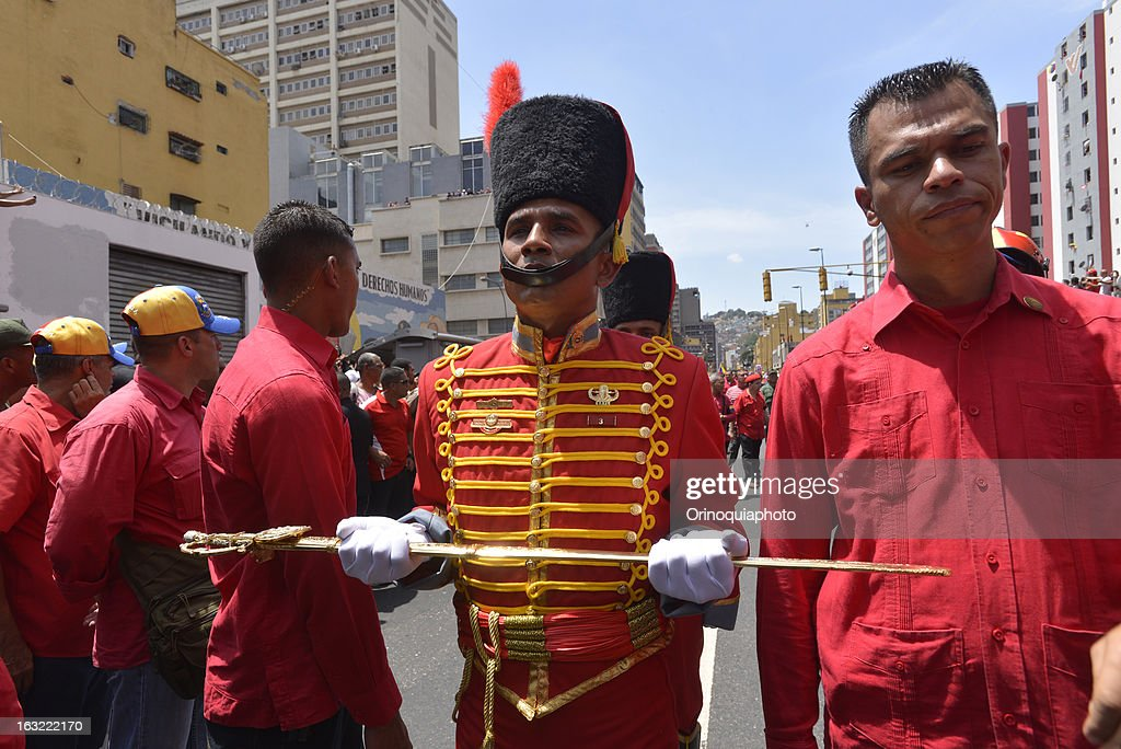 Honor guard carries the sword of Simon Bolivar during Chavez funeral.