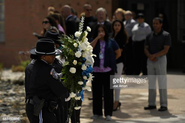 Honor Guard deputy's carry the wreath past the assembled crowd during the Denver Sheriff Department memorial ceremony for DSD officers who have died...
