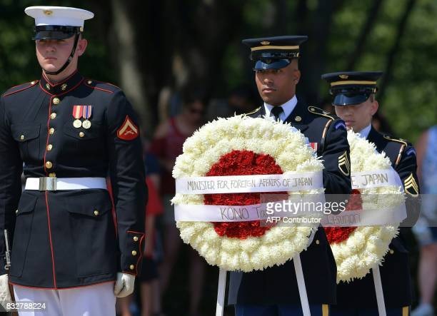 US honor guard hold a wreath before Japan's Foreign Minister Tar Kno and Defense Minister Itsunori Onodera to lay it at the Tomb of the Unknown...
