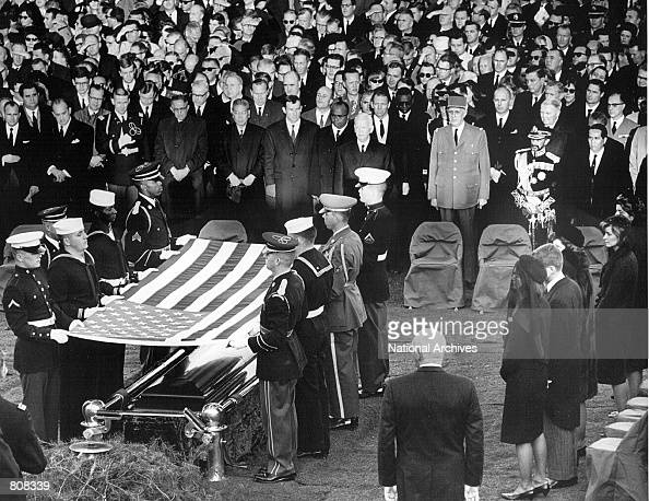 Honor guard place a flag over the casket of President John F Kennedy during his funeral service November 25 1963 in Arlington Cemetery