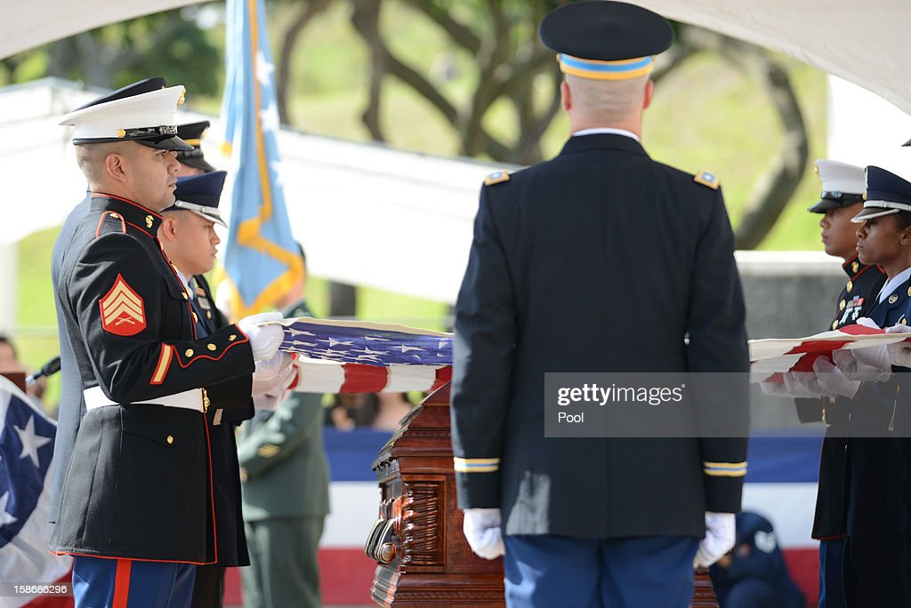 Honor Guard prepare to fold the flag during the funeral services for the late Senator Daniel Inouye at the National Memorial Cemetery of the Pacific December 23, 2012 in Honolulu, Hawaii. Senator Inouye was a Medal of Honor recipient and a United States Senator since 1963.