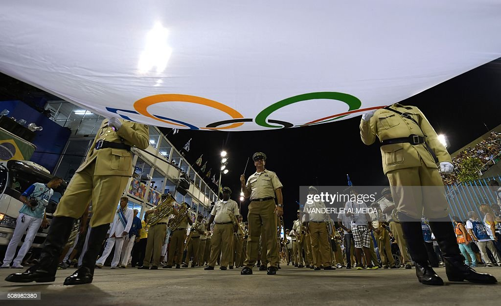 Honor guards carry the Olympic flag during the opening ceremony on the first day of parades at the Sambadrome in Rio de Janeiro, Brazil on February 7, 2016. AFP PHOTO/ VANDERLEI ALMEIDA / AFP / VANDERLEI ALMEIDA