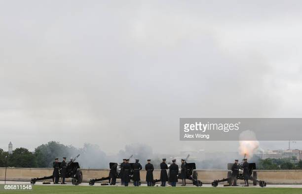Honor guards fire a 19gun salute during a full honor parade for the North American Defense Ministerial at the Pentagon May 22 2017 in Arlington...