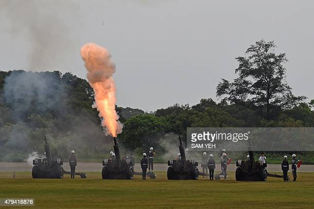 Honor guards fire cannons during the 70th Anniversary of the WWII at the Huko military in northern Hsinchu on July 4 2015 War veterans gathered for a...
