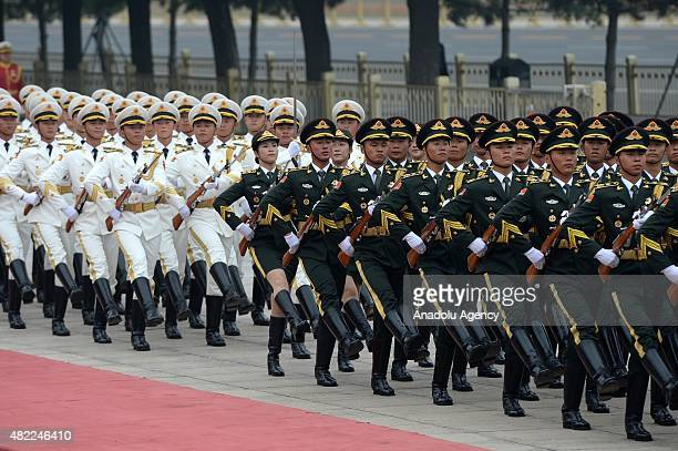 Honor Guards march as the President of Turkey Recep Tayyip Erdogan welcomed by Chinese President Xi Jinping during an official welcoming ceremony...