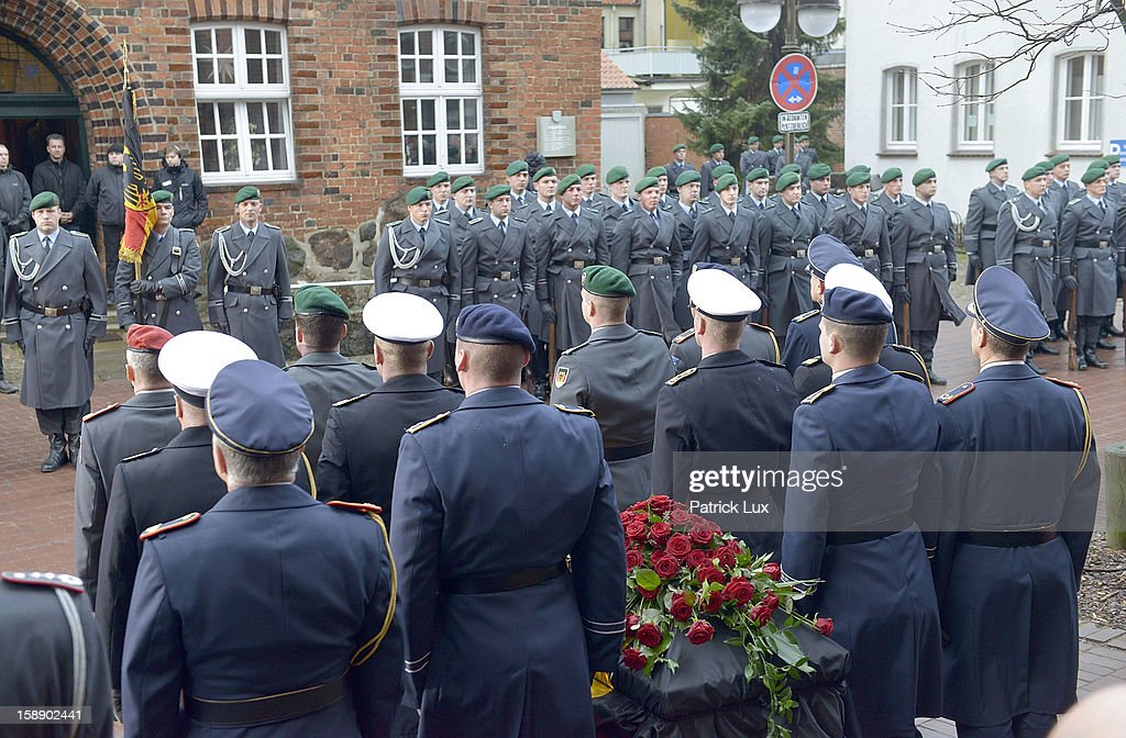Honor guards of the Bundeswehr pay their last respect to the coffin of former German Defence Minister Peter Struck after a memorial service on January 3, 2013 in Uelzen, Germany. Struck was a leading member of the German Social Democrats (SPD) and died in December following a heart attack.
