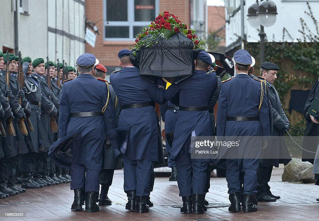 Honor guards of the Bundeswehr pay their last respects to the coffin of former German Defence Minister Peter Struck after a memorial service on January 3, 2013 in Uelzen, Germany. Struck was a leading member of the German Social Democrats (SPD) and died in December following a heart attack.