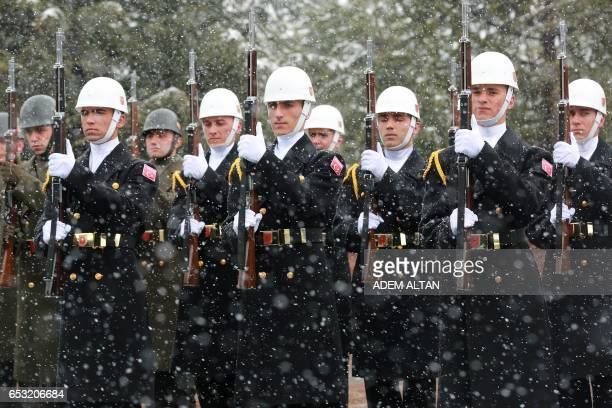 TOPSHOT Honor guards stand at the Cankaya Palace in Ankara on March 14 2017 / AFP PHOTO / ADEM ALTAN