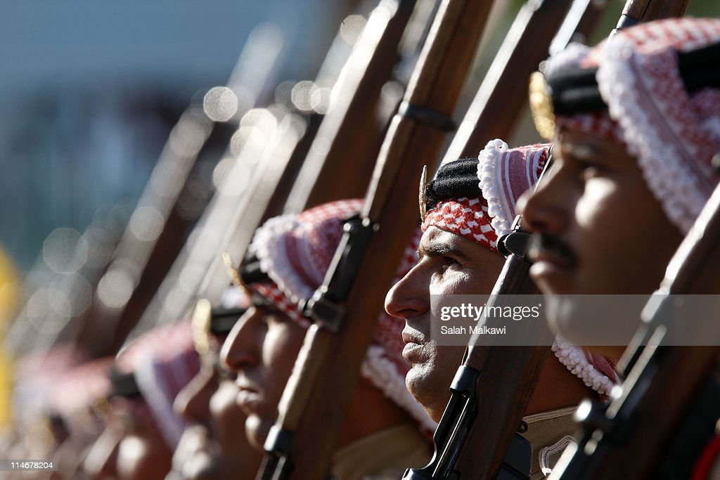 Honor guards stand for the arrival of Jordan's King Abdullah at an official celebration for the 65th anniversary of Independence on May 25, 2011 in Amman, Jordan. The Hashemite Kingdom of Jordan gained independence from Britain on May 25, 1946.