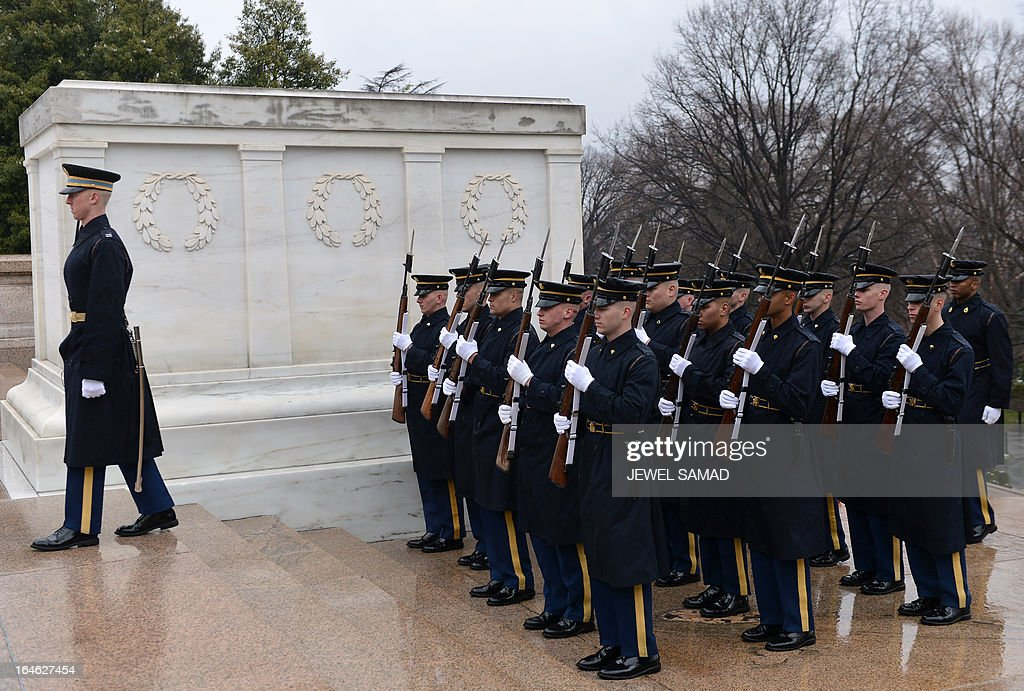 Honor guards take position as Medal of Honor recipients place a wreath at the Tomb of the Unknows at the Arlington National Cemetery in Arlington, Virginia, on March 25, 2013 to mark the 150th anniversary of Medal of Honor, the nation's highest award for wartime acts of valor. AFP PHOTO/Jewel Samad