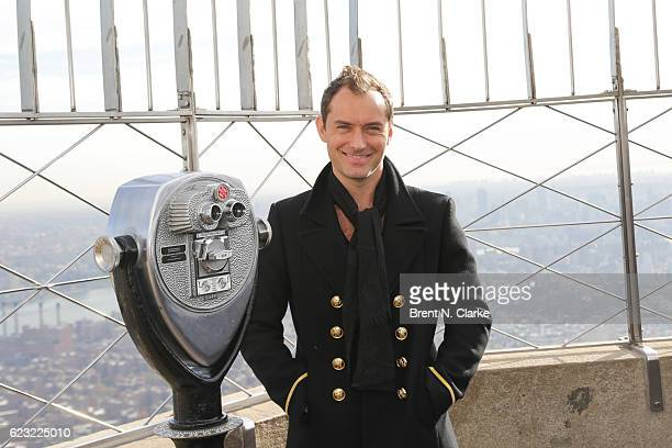 Honorary board member of Only Make Believe/recipient of the Sir Ian McKellen award for philanthropy actor Jude Law poses for photographs after...