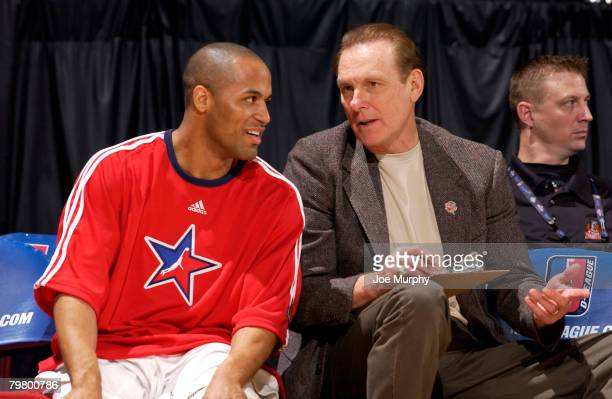 Honorary captain Rick Berry of the Red Team talks to team member Eddie Gill during the DLeague AllStar Game Presented by Spalding on center court...
