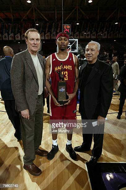 Honorary Captains Rick Berry and Lenny Wilkens pose with Jeremy Richardson of the Red Team and his MVP Trophy during the DLeague AllStar Game...