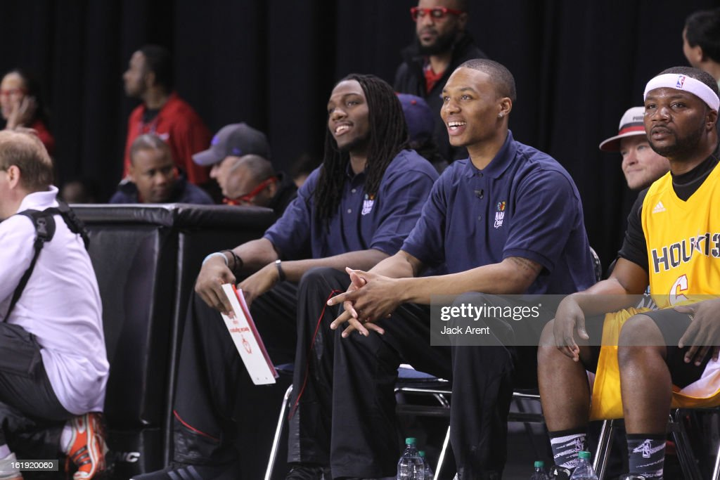 Honorary Coaches Damian Lillard and Kenneth Faried of the West All-Stars react to a play against the East All-Stars during the NBA Cares Special Olympics Unified Sports Basketball Game on Center Court at Jam Session during the NBA All-Star Weekend on February 17, 2013 at the George R. Brown Convention Center in Houston, Texas.