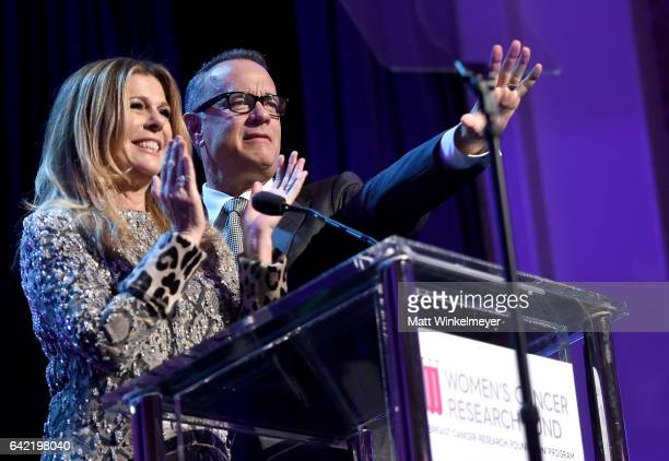 Honorary CoChairs Rita Wilson and Tom Hanks speak onstage during WCRF's 'An Unforgettable Evening' presented by Saks Fifth Avenue at the Beverly...