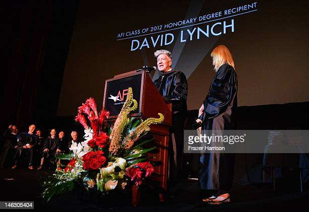 Honorary degree recipient director David Lynch with actress Laura Dern on stage at the 2012 AFI Conservatory Commencement Ceremony at Grauman's...