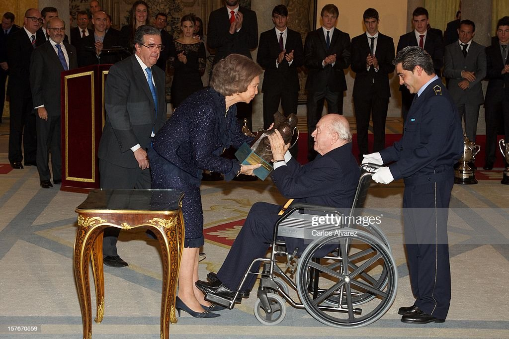 Honorary President of Real Madrid, <a gi-track='captionPersonalityLinkClicked' href=/galleries/search?phrase=Alfredo+Di+Stefano&family=editorial&specificpeople=642804 ng-click='$event.stopPropagation()'>Alfredo Di Stefano</a> receives from <a gi-track='captionPersonalityLinkClicked' href=/galleries/search?phrase=Queen+Sofia+of+Spain&family=editorial&specificpeople=160333 ng-click='$event.stopPropagation()'>Queen Sofia of Spain</a> the Francisco Fernandez Ochoa National Prize during the National Sports Awards ceremony at El Pardo Palace on December 5, 2012 in Madrid, Spain.