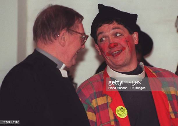 Honorary Priest The Reverend Roly Bain alias Roly the clown shares a joke with Father Michael Shrewsbury before 50th annual clown service at the...
