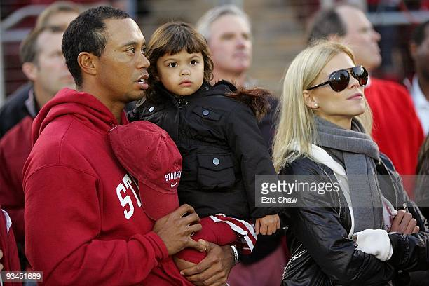 Honorary Standford Cardinal captain Tiger Woods his daugher Sam and wife Elin Nordegren stand on the sidelines before the Cardinal game against the...