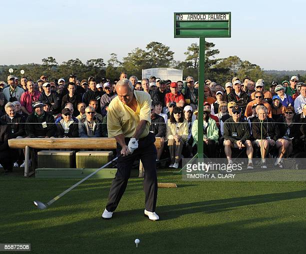 Honorary starter Arnold Palmer gives a fist pump after hitting his tee shot on the 1st hole to start the 1st round at Augusta National Golf Club...
