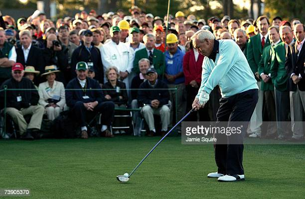 Honorary starter Arnold Palmer swings through the ball on the first tee during the first round of the 2007 Masters Tournament at Augusta National...