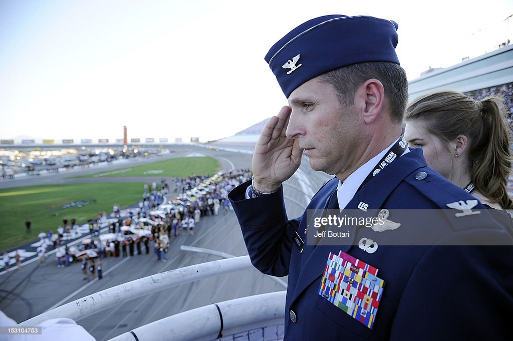 Honorary starter Col. Barry Cornish salutes during the pre-race national anthem prior to the start of the NASCAR Camping World Truck Series Smith's 350 at Las Vegas Motor Speedway on September 29, 2012 in Las Vegas, Nevada.