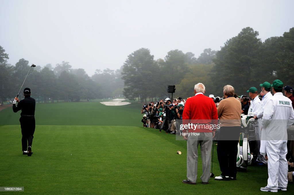 Honorary starter <a gi-track='captionPersonalityLinkClicked' href=/galleries/search?phrase=Gary+Player&family=editorial&specificpeople=203189 ng-click='$event.stopPropagation()'>Gary Player</a> of South Africa tees off as <a gi-track='captionPersonalityLinkClicked' href=/galleries/search?phrase=Arnold+Palmer&family=editorial&specificpeople=93096 ng-click='$event.stopPropagation()'>Arnold Palmer</a> of the United States and <a gi-track='captionPersonalityLinkClicked' href=/galleries/search?phrase=Jack+Nicklaus&family=editorial&specificpeople=93565 ng-click='$event.stopPropagation()'>Jack Nicklaus</a> of the United States look on to start the first round of the 2013 Masters Tournament at Augusta National Golf Club on April 11, 2013 in Augusta, Georgia.