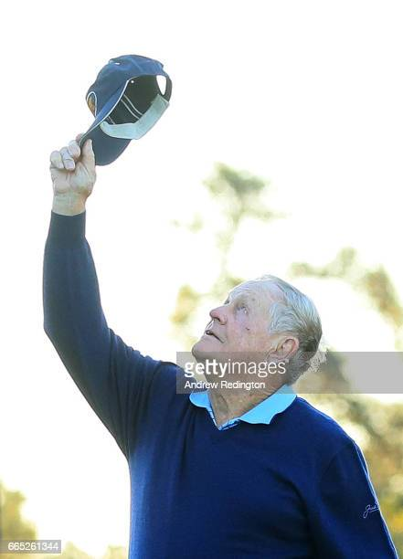 Honorary starter Jack Nicklaus holds up his hat in honor of Arnold Palmer during the first tee ceremony prior to the first round of the 2017 Masters...
