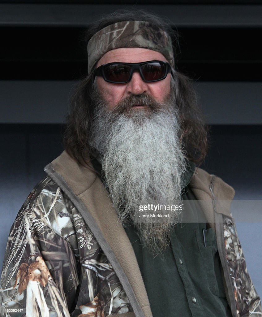 Honorary Starter, reality TV personality <a gi-track='captionPersonalityLinkClicked' href=/galleries/search?phrase=Phil+Robertson&family=editorial&specificpeople=4043277 ng-click='$event.stopPropagation()'>Phil Robertson</a> is introduced during pre-race ceremonies for the NASCAR Sprint Cup Series Duck Commander 500 at Texas Motor Speedway on April 6, 2014 in Fort Worth, Texas.