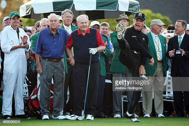 Honorary Starters Arnold Palmer and Jack Nicklaus of the United States wait alongside Gary Player of South Africa on the first tee during the first...