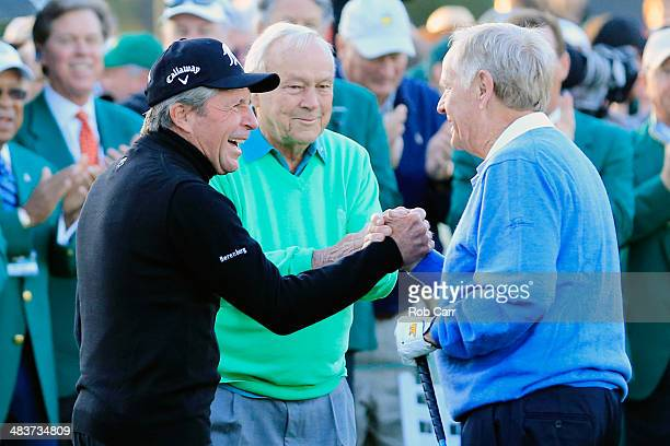 Honorary starters Gary Player Arnold Palmer and Jack Nicklaus greet each other on the first tee at the start of the first round of the 2014 Masters...