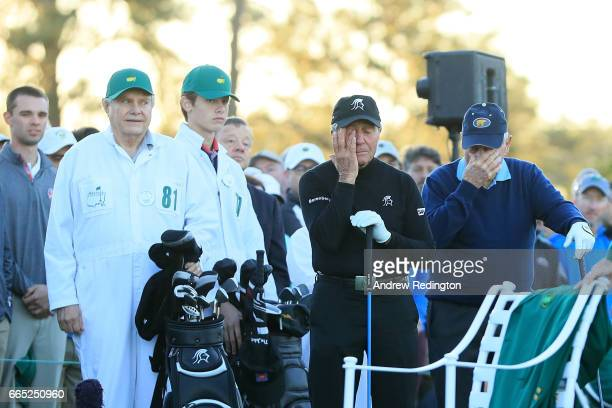 Honorary starters Jack Nicklaus and Gary Player react as they remember Arnold Palmer as during the first tee ceremony prior to the first round of the...