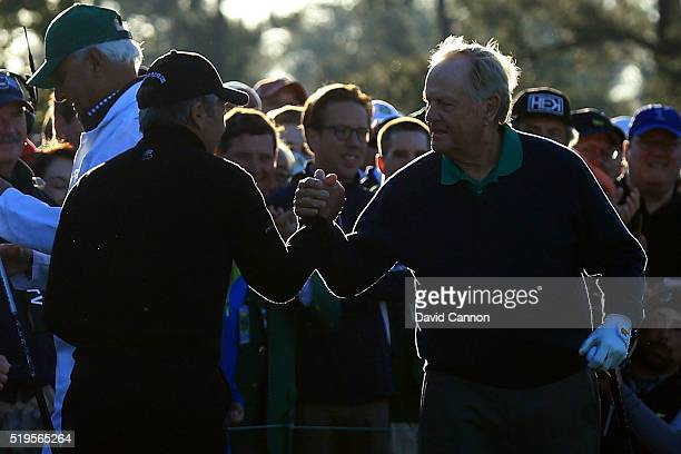 Honorary starters Jack Nicklaus and Gary Player shake hands during the ceremonial tee off to start the first round of the 2016 Masters Tournament at...