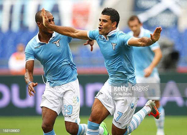 Honorato Ederson with his teammate Abdoulay Konko celebrates after scoring the opening goal during the Serie A match between SS Lazio and AC Siena at...